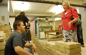 Baroness Hanham speaking to a construction trainee