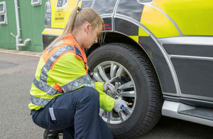 Traffic officer checking tyres