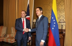 Foreign Secretary Dominic Raab shaking hands with the Venezuelan Interim-President Juan Guaidó