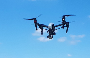 Drone airborne in blue sky