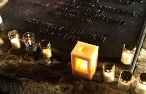 A Holocaust Memorial consisting of a lit candle