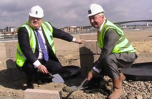 Eric Pickles laying a foundation stone