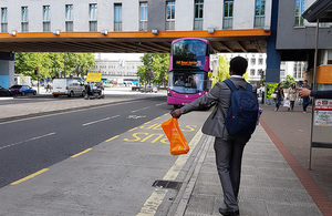 Boy stopping a bus
