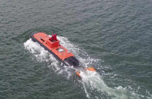 Aerial view of submersible vessel travelling above the waterline. Image credit: MSubs Ltd