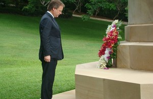 Minister Hugo Swire lays a wreath during his visit to the Bomana war cemetery