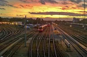 Image of train on tracks at sunset.