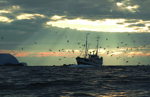 fishing vessel at sunset