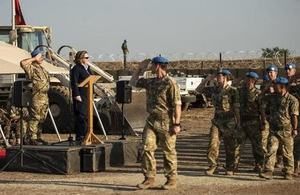 Minster for the Armed Forces Anne-Marie Trevelyan receiving the salute