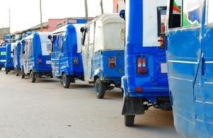 Mini vans queued on a road