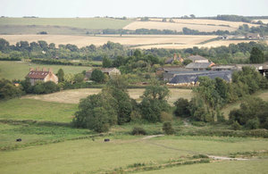 Rural buildings surrounded by fields and trees