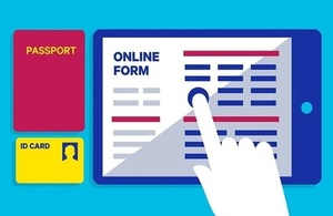Image of passport, ID card and online form