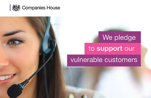 Woman wearing a headset and microphone with text saying 'We pledge to support our vulnerable customers'.
