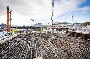 A concrete pour taking place on the Sellafield site with workers in the background