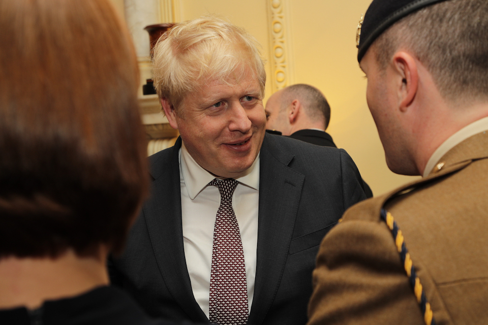 Prime Minister Boris Johnson talking to nominees at the Downing Street reception