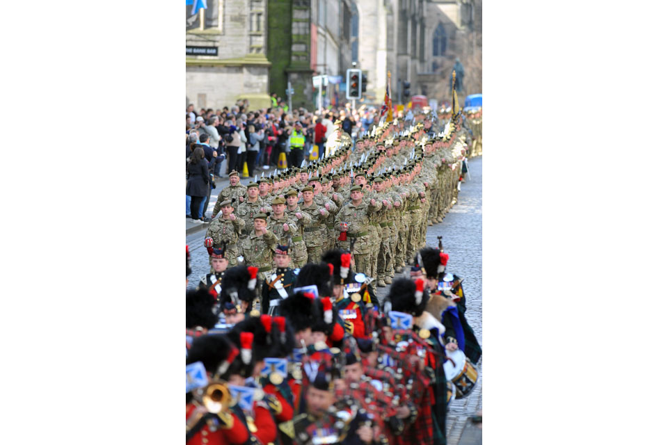 Soldiers march down the Royal Mile