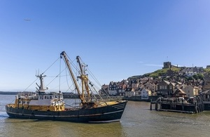 Whitby harbour with fishing boat