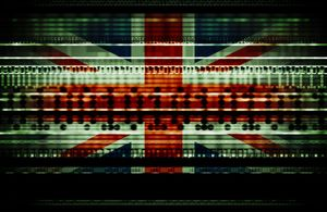 British Union Jack blended with binary numbers and data streams representing data usage, cyber crime, national security