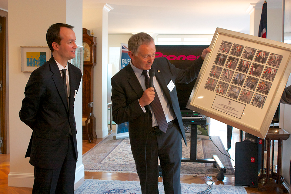 Richard Scudamore presents Danny Lopez with a framed gift.