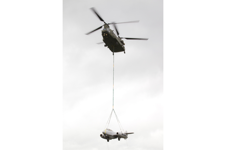 The Meteor gate guardian suspended below the Chinook helicopter