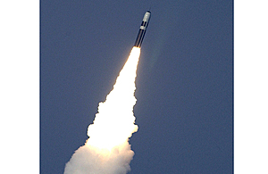 A Trident II D5 Missile breaking the surface, having been fired from HMS Vanguard, a Strategic Missile Submarine.