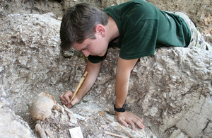 Private Harry Buxton excavates the body of an Anglo-Saxon woman
