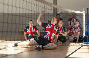 Members of the UK Team participating in next month's US Warrior Games practice their sitting volleyball techniques.