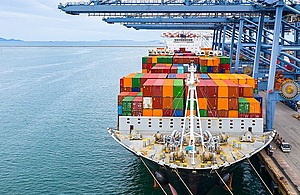 Image of large ship loaded with colourful shipping containers