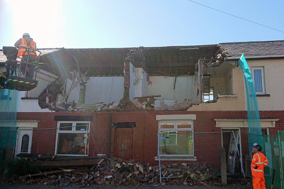 The damaged properties being demolished by hand.