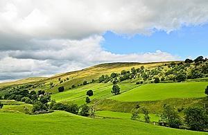 Rolling hills under a blue sky