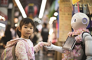 A girl greets a robot in an urban setting