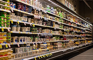A photo of dairy products on supermarket shelves