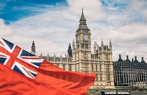 Red ensign in front of houses of parliament