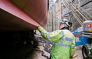 Surveyor inspecting hull