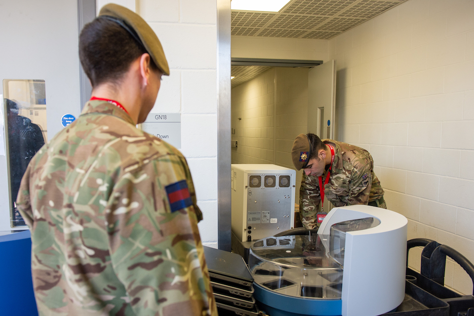 Members of the Coldstream Guards delivering testing equipment. MOD Crown Copyright.
