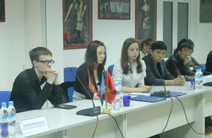 School pupils and university students taking part in the round table discussion