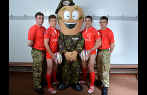 'Private Parts' with members of the British Army rugby team, helping to raise awareness of testicular cancer [Picture: Corporal Steve Blake, Crown copyright]