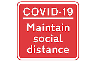 Image of COVID-19 maintain social distance sign.