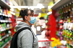 Lady in shop wearing face mask