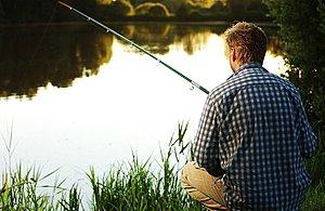 A man fishing alone.