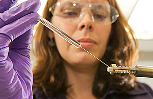 Scientist with a pipette