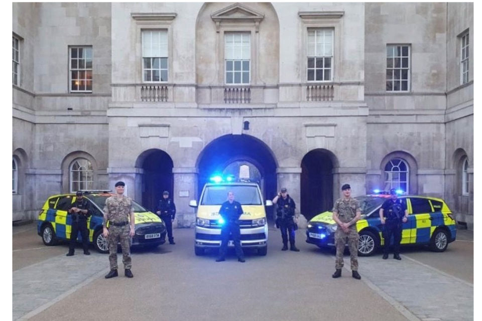 Image of military personnel and Ministry of Defence police at the Clap for our Carers at Whitehall, MDP with colleagues from London Ambulance Service and the British Army, HQ London District.