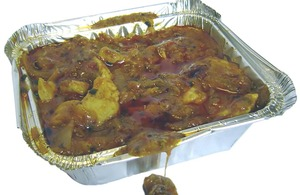 Curry in a takeaway container