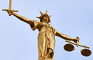 The statue of justice on top of the Old Bailey