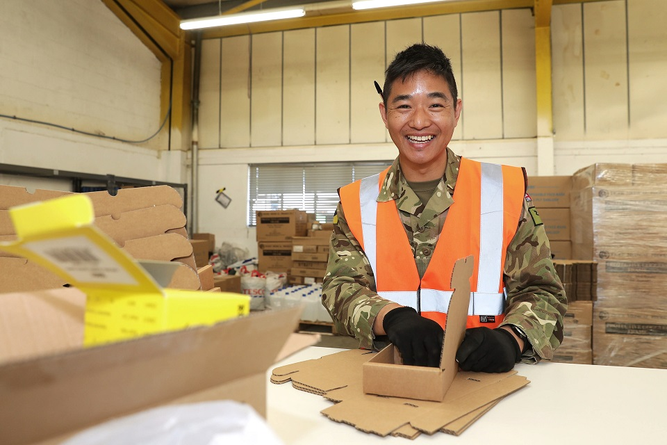 Corporal prepares PPE for local schools.