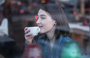 Smiling girl with coffee cup