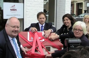 Eric Pickles, Kirsty Allsop and Grant Shapps cut red tape off a model house