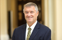 Dr Alastair McPhail CMG OBE
