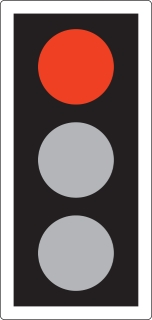 RED means 'Stop'. Wait behind the stop line on the carriageway