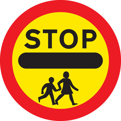 School crossing patrol ahead (some signs have amber lights which flash when crossings are in use)