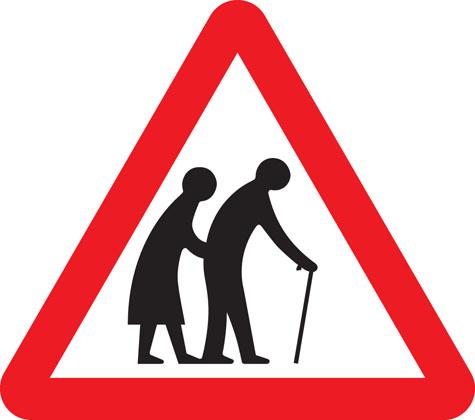 https://assets.publishing.service.gov.uk/media/55b76ddc40f0b6790f00001b/warning-sign-frail-pedestrians-cross-road-ahead.jpg